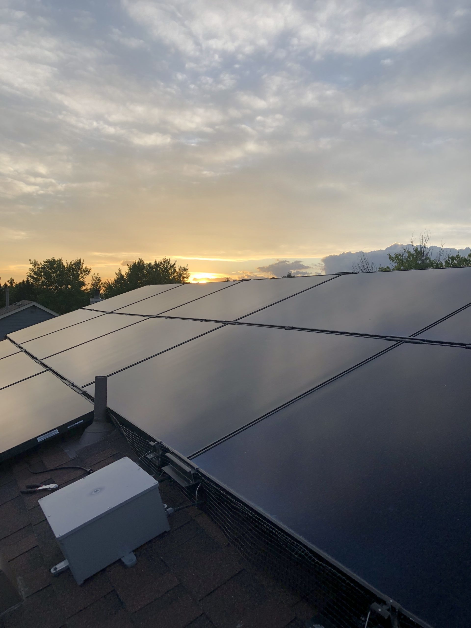 Solaria solar panels on a roof at sunset